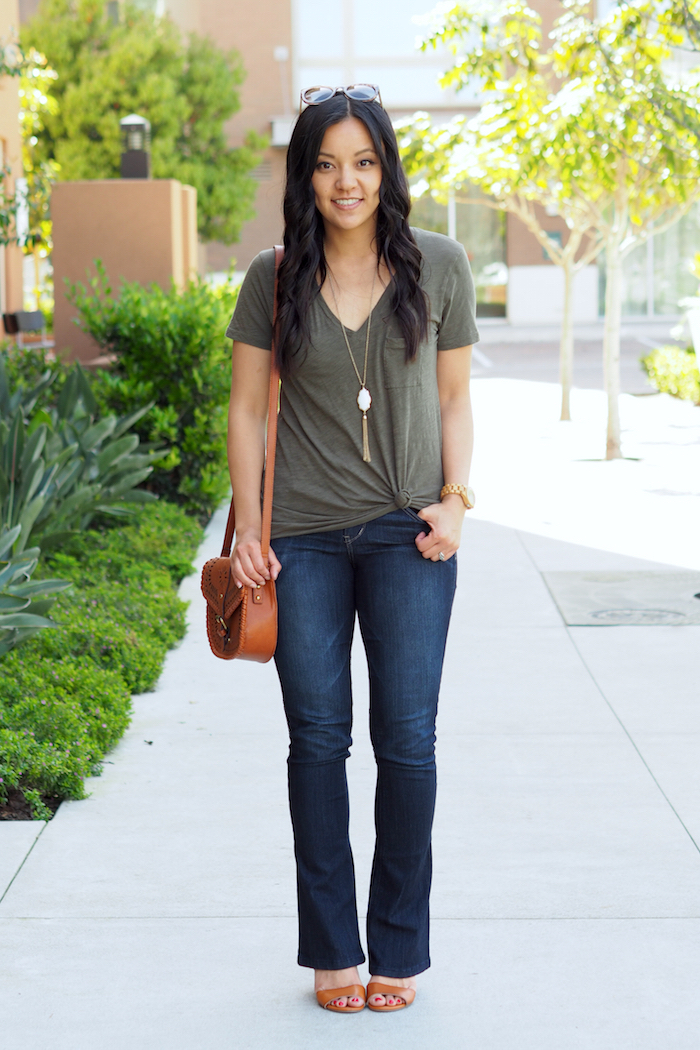 olive tee + bootcut jeans + cognac accessories