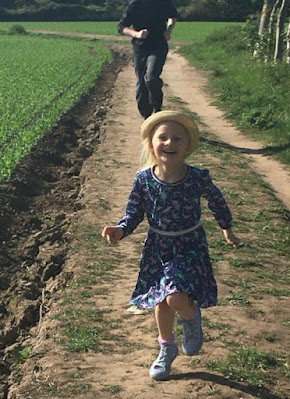 Enjoying walks in the countryside with her family.