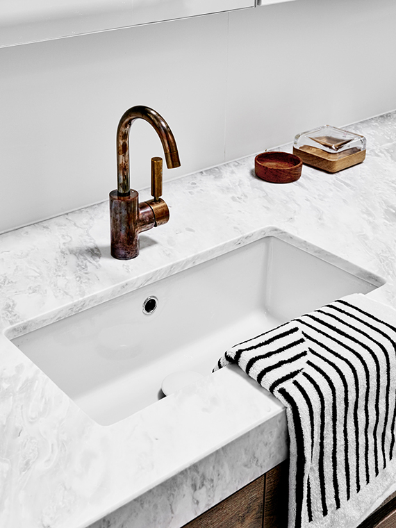 Bathroom sink | Hampton Penthouse. Interior design by Huntly, photo by Brooke Holm