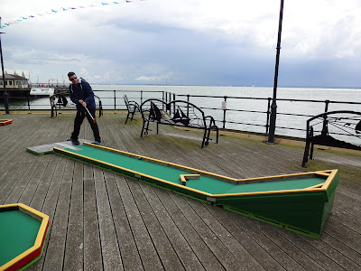Putting on the Southend Pier Crazy Golf course