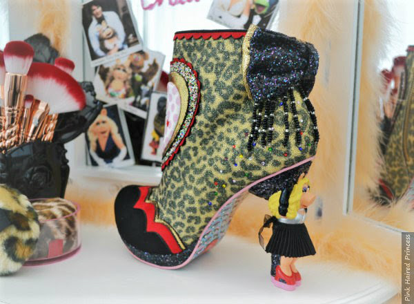 back view of Irregular Choice Disney Muppets Fierce Piggy boots backstage dressing table scene
