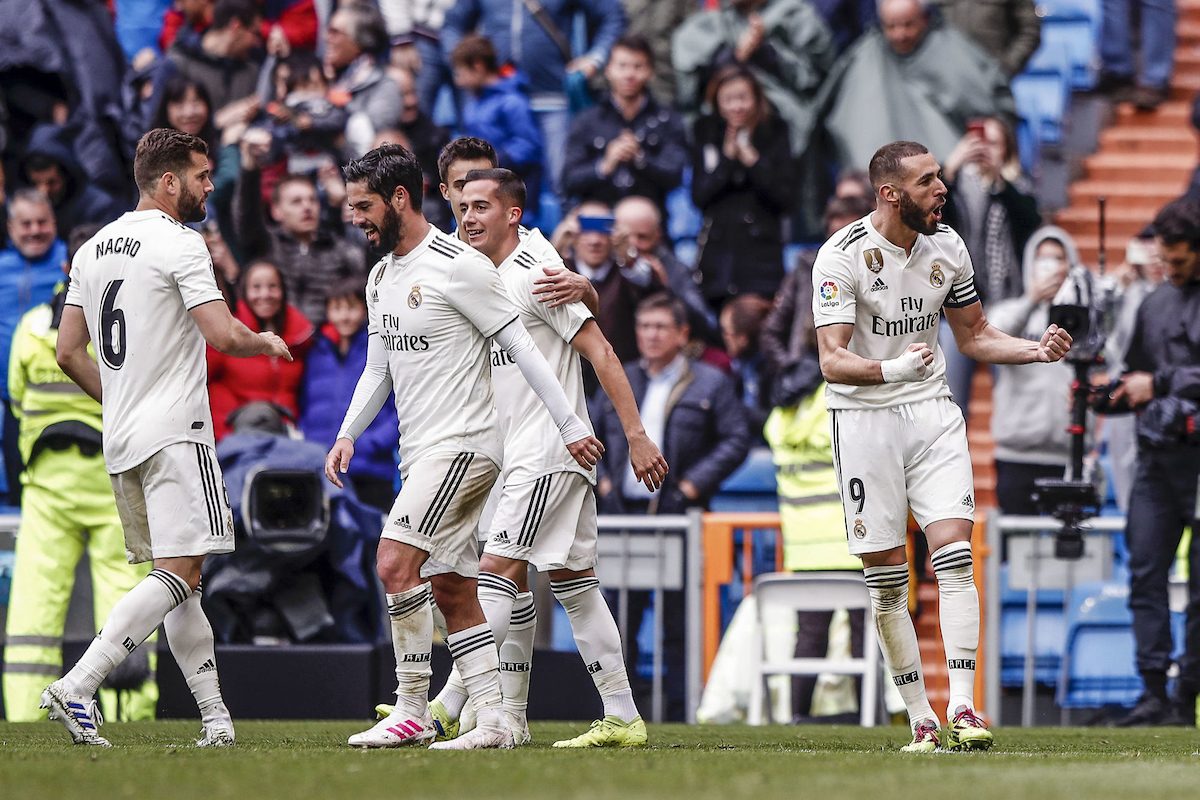 Real Madrid players celebrate a goal