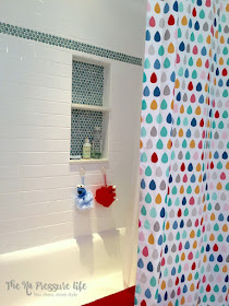 Aqua penny tile with subway tile