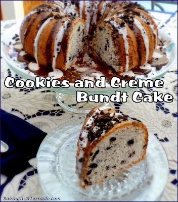Cookies and Crème Bundt Cake is a moist cake that starts with a mix, adds in cookies and crème flavors and cookie chunks, then is double drizzled and topped with more cookie crumbs. | Recipe developed by www.BakingInATornado.com | #recipe #cake