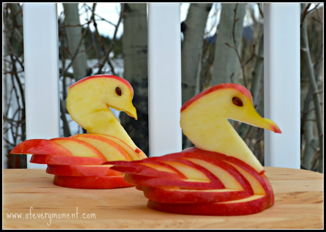 two swans carved out of apples