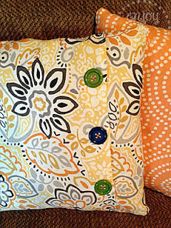print pillows on a couch