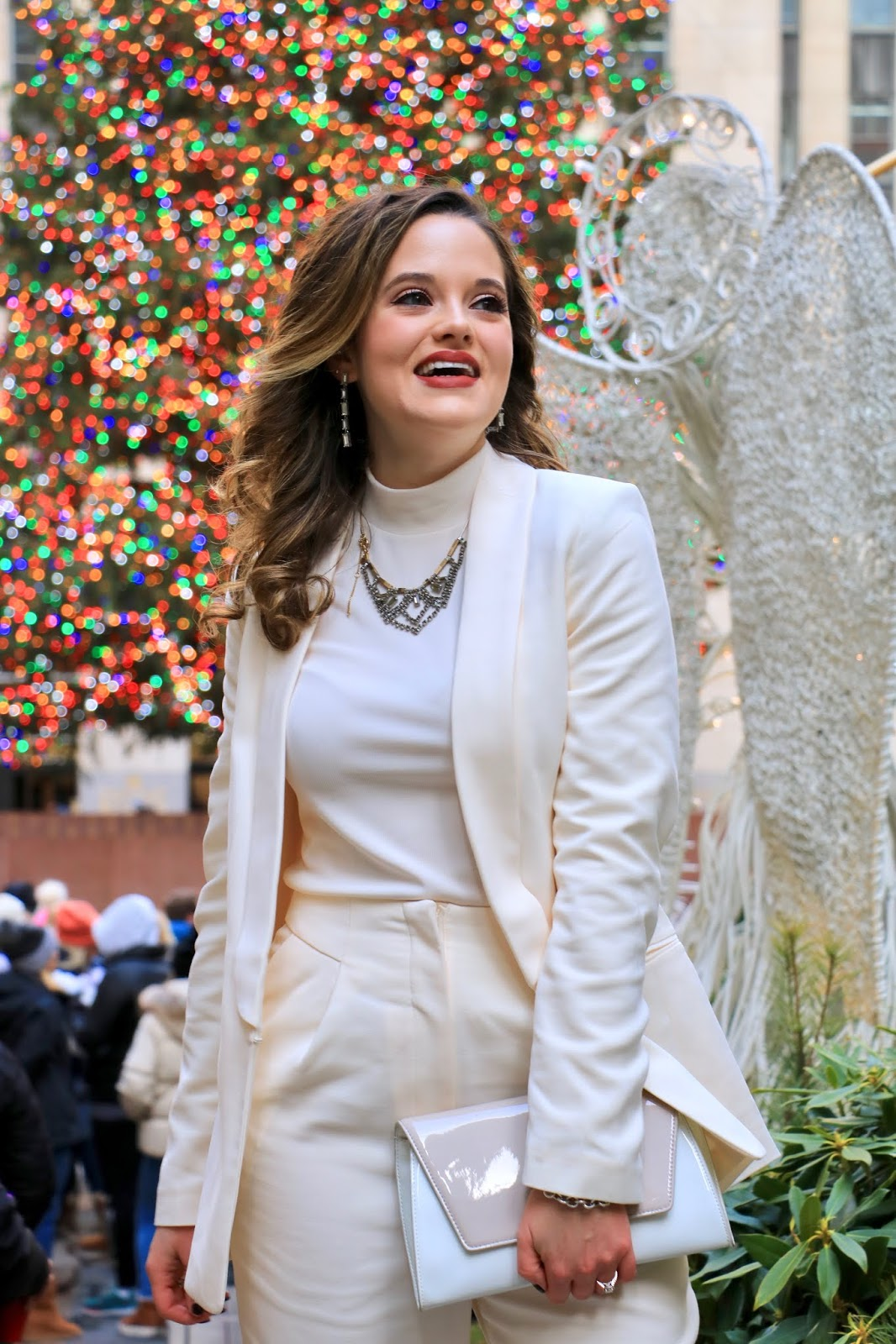 Nyc fashion blogger Kathleen Harper wearing an all-white suit.