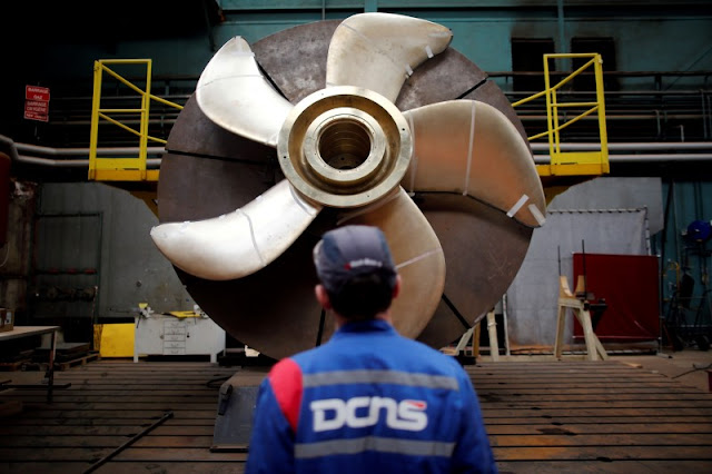 Image Attribute: File photo of an employee looking at the propeller of a Scorpene submarine at the industrial site of the naval defence company and shipbuilder DCNS in La Montagne near Nantes, France, April 26, 2016. REUTERS/Stephane Mahe/Files