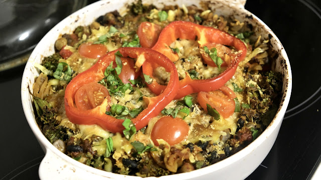 Kale And Bean Pasta Bake with red bell pepper in a white dish