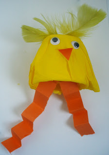 A little yellow chick made from a yoghurt container