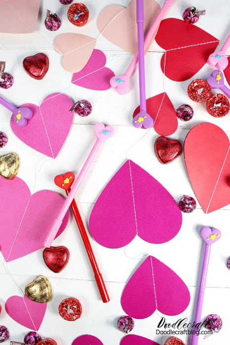Hearts, candy and heart shaped pens in pinks and reds perfect for Valentine's day!