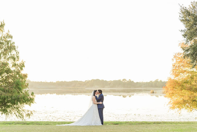 bride and groom kissing at lake mary events center