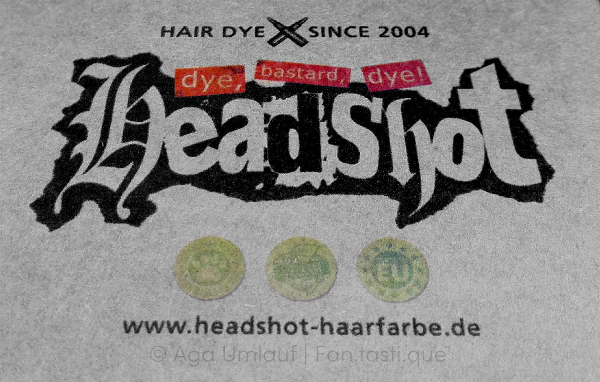 the logo of Headshot Haarfarbe, printed on the cardboard box they ship their hair dyes in
