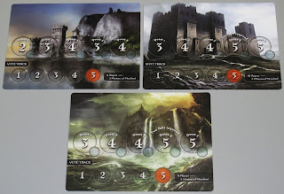 Three play mats, each abut 7 inches by 5 inches (18 cm by 13 cm), with different background artwork on each one. The one on the upper left shows a castle on the coast with a series of cliffs behind it. The one on the upper right shows a large and imposing castle on rocky terrain. The one on the bottom shows ocean waves crashing against a cliff during a rainstorm. All three mats have three sections. A small rectangle in the bottom right of each mat shows how many players that mat is used for: 6 Players with 2 Minions of Mordred for the upper left mat, 10 Players with 4 Minions of Mordred for the upper right mat, and 8 Players with 3 Minions of Mordred for the bottom mat. To the right of this rectangle is the Vote Track, a row of five circular spaces numbered 1 through 5, with the fifth space coloured red. The vote track is identical on all three mats. Running along the centre of the mat, from left to right, is a row of three large circular spaces, each with a small circular space overlapping it slightly below it and to the right of it. On the 6 player mat, the spaces are labelled: Quest 1 - 2; Quest 2 - 3; Quest 3 - 4; Quest 4 - 3; Quest 5 - 4. The 10 player mat and the 8 player mat are both labelled: Quest 1 - 3; Quest 2 - 4; Quest 3 - 4; Quest 4 - 5; Quest 5 - 5. These two mats also have an additional label above the space for quest 4 that reads: Two Fails Required.