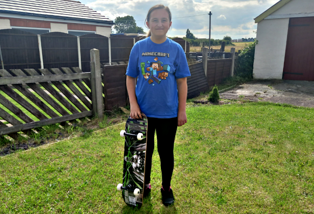 Youngest holding a skateboard