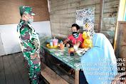 Serda Dodi Eka Putra Babinsa Koramil 10/Pelangiran Kodim 0314/Inhil Maksimalkan  Terapkan Protokol Kesehatan di Pasar Pelangiran