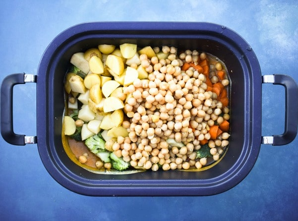 Vegetable curry ingredients in slow cooker pot