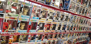 A wall of Funko Pops at Acme Comics in Sioux City