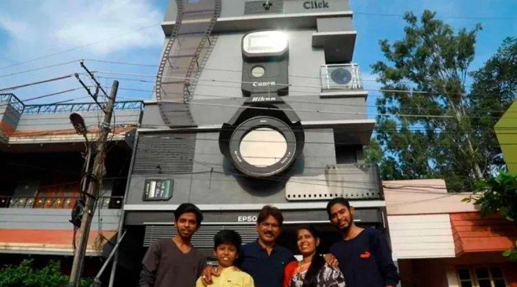 Construyó su casa con forma de cámara y llamó a sus hijos Canon, Nikon y Epson