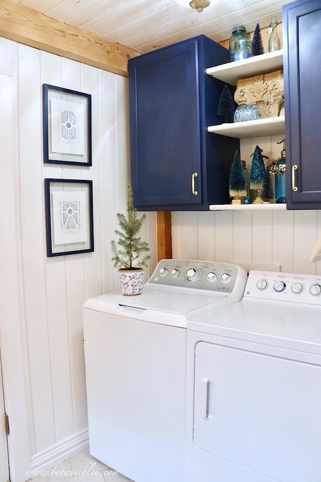 Blue Christmas Laundry Room decorated early with blue bottle brush trees