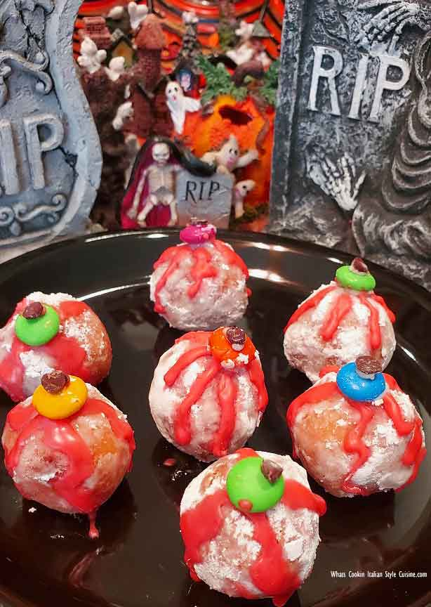 donut holes filled with jelly made into eyeballs for Halloween foods