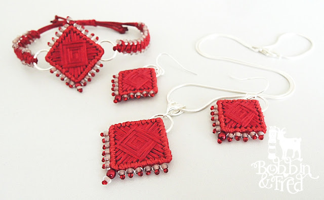Needlepoint jewellery set in red tones