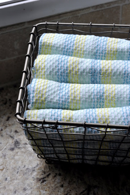 Tidy Cloths in Wire Basket | Taste As You Go