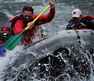 Picture of Becky Southwell husband Dylan Neal rifting in a boat