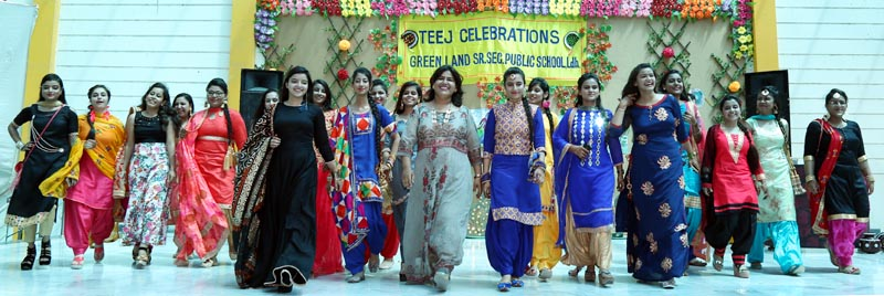 Students walk on stage during Teej Celebrations at Green Land School