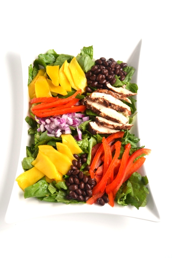 Caribbean Grilled Chicken Salad is made with a flavorful dry-rubbed grilled chicken, juicy mangoes, red peppers and black beans with lime vinaigrette! www.nutritionistreviews.com