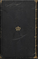 Cover of book in black morocco leather with msall gold crown stamped in center.