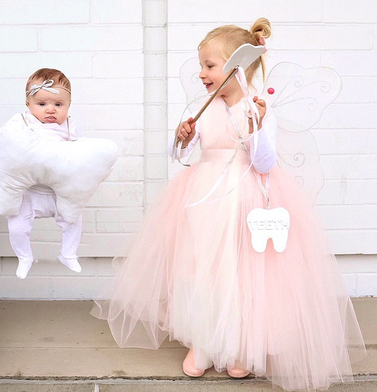 "Our Tooth fairy and baby tooth costume was so fun to make! And as a mom of a 3.5 month old and toddler these costumes required me to cut up the project into a few nights. Which I wasn't at all surprised!! So after being such a big hit over in instagram, I decided to once again move our series over here to the blog as well so that all the materials can be listed in one easy spot for you. Below is each detail for both Abby's Tooth Fairy and Emmas costume, starting with Abby's pink fluffy dress.   Then, a tutorial/demo for every detail (including her dress) is uploaded over in instagram under my story highlights titled, ""DIY Tooth Fairy."""
