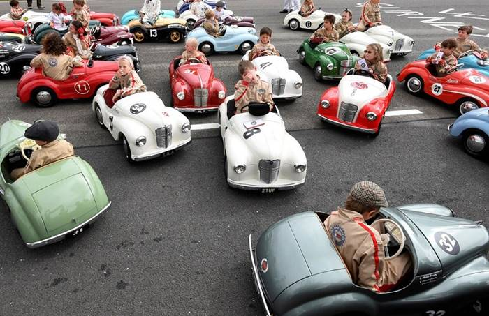 Children's race on the pedal cars during the festival Goodwood Revival classic racing cars. Southern United Kingdom, September 9th. Author: