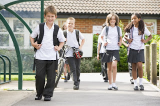 kids walking to school with backpacks on