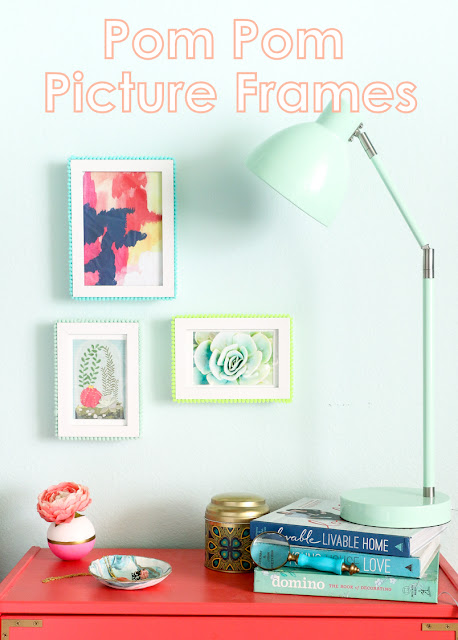 Easy DIY Pom Pom Picture frames. Use pom pom trim and hot glue to craft your own pop of color picture frames for a colorful gallery wall.