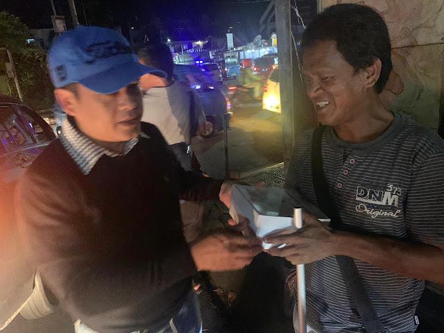 KHB Melakukan Aksi Sosial Dengan Warga Manado