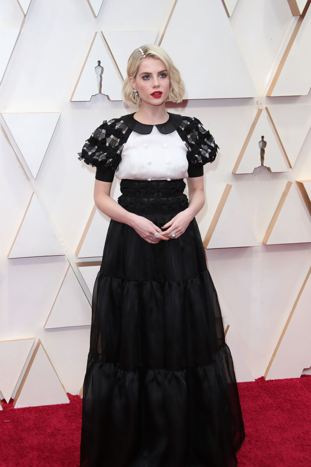Lucy Boynton arrives in monochrome Chanel to the 2020 Oscars in Hollywood