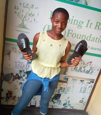 Favour holding Sandals