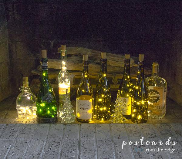 fairy lights inside of wine bottles