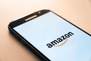 Black Samsung galaxy phone displaying Amazon logo