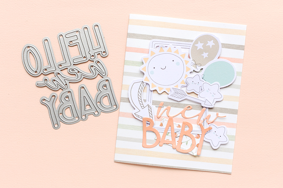 Hello New Baby die and a new baby card with fun die-cuts by Moda Scrap Mojosanti Sandra Dietrich
