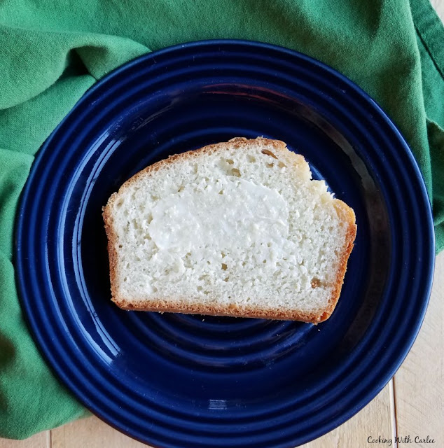 slice of bread with butter spread over it