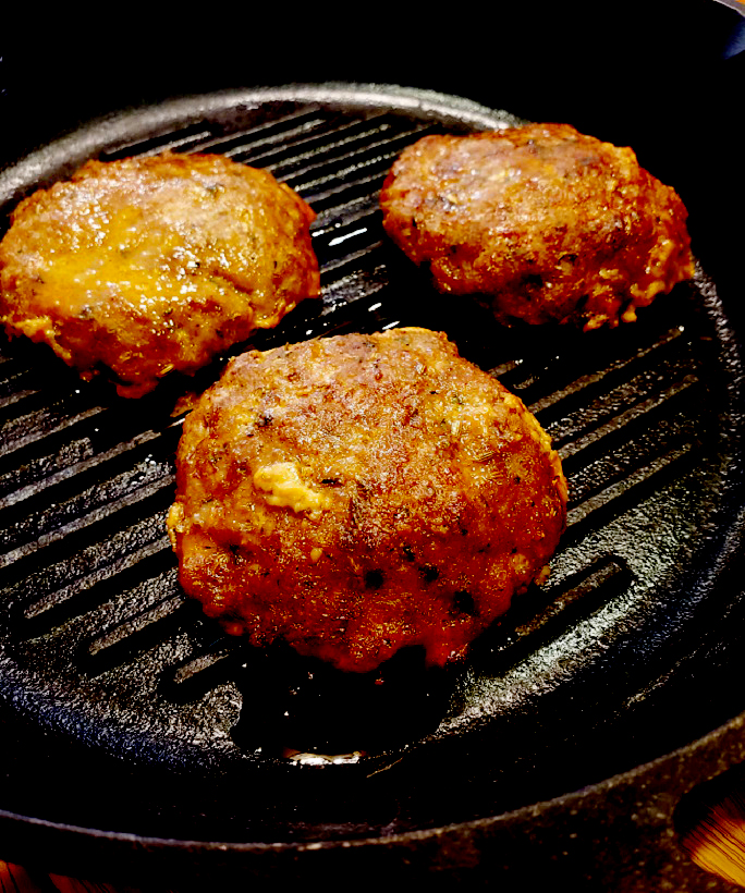 homemade sausage patties in cast iron skillet