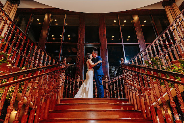 bride and groom photos on grand staircase