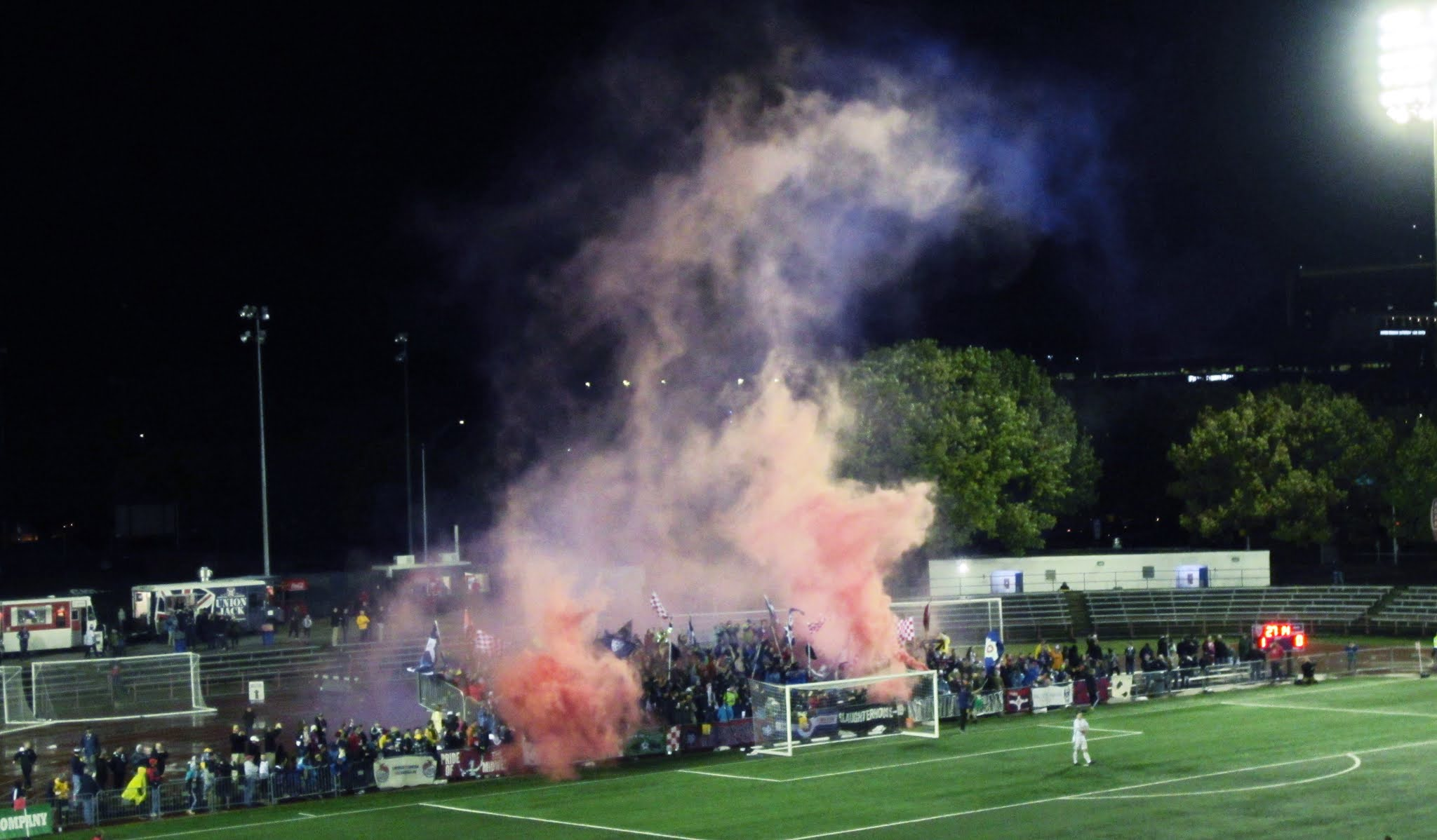 A flare goes off in the Brickyard Battalion section inside Carroll Stadium, IUPUI