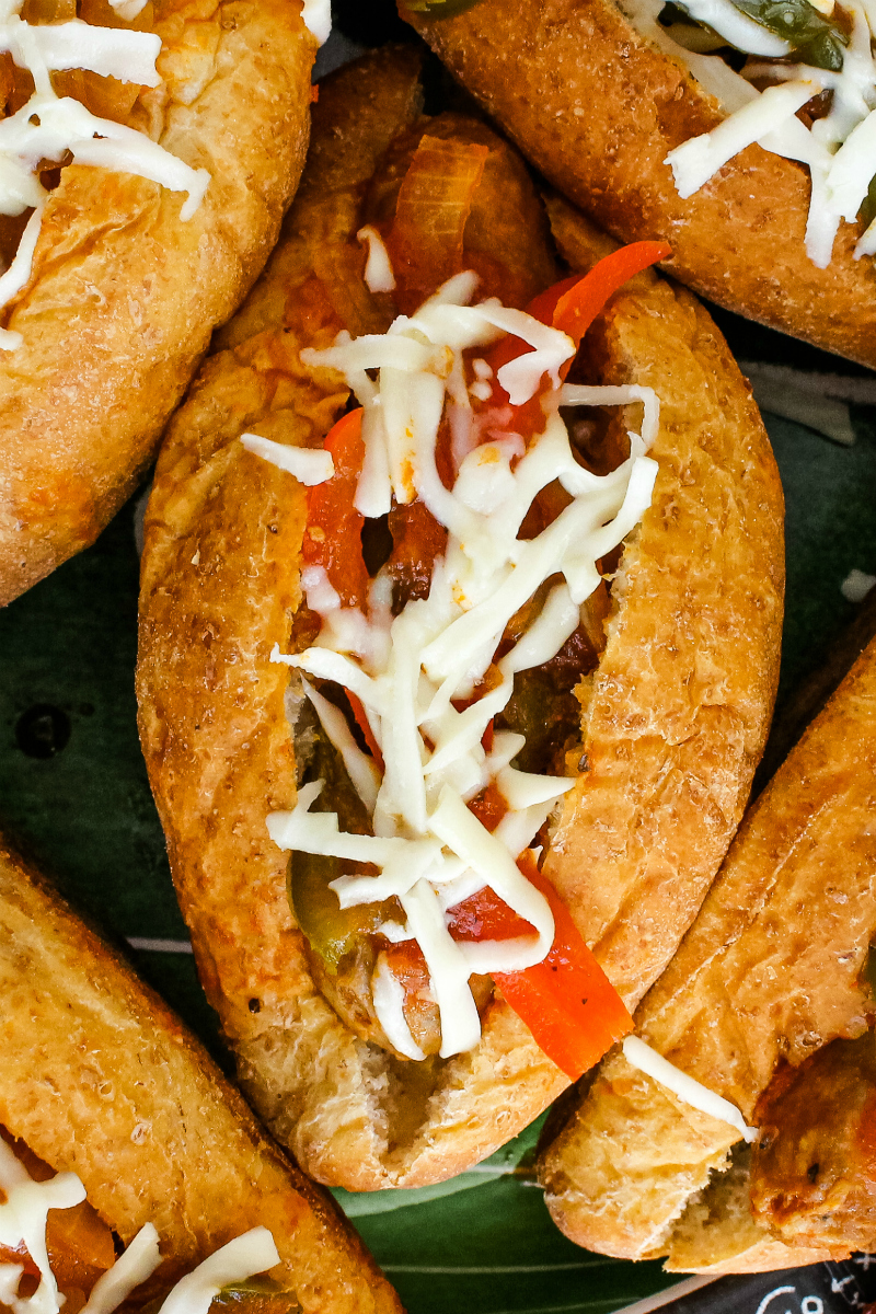 Slow Cooker Sausage, Pepper, and Onion Sandwiches are easily made with just six ingredients! Marinara sauce mingles with Italian sausages and fresh veggies in your slow cooker to make a sandwich that you will want to make again and again. #sausagesandwiches #slowcooker