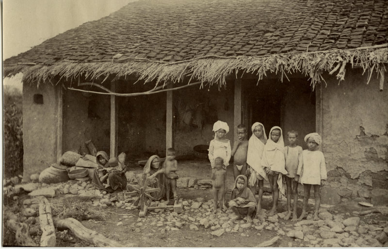 Indian Women and Children Outside of a Hut - c1880's