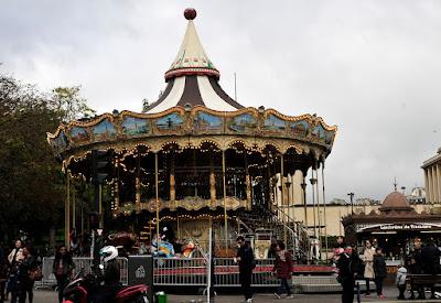 Merry go round near Tower Eiffel in Paris