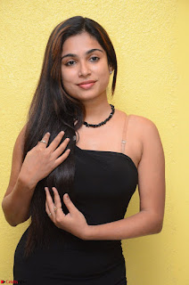 Vrushali Gosavi in strapless Short Black Dress At Follow Follow U Audio Launch 046.JPG