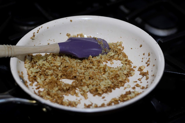 Browned Panko bread crumbs in the pan.